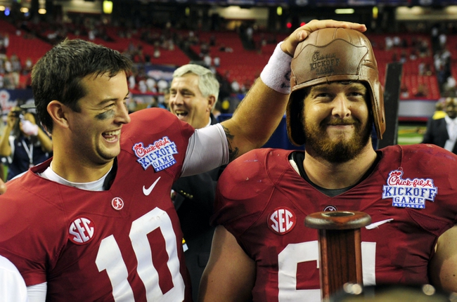 Aug 31, 2013; Atlanta, GA, USA; Alabama Crimson Tide quarterback AJ McCarron (10) offensive linesman Anthony Steen (61) after defeating the Virginia Tech Hokies 35-10 in the 2013 Chick-fil-a Kickoff game at the Georgia Dome. Mandatory Credit: Daniel Shirey-USA TODAY Sports