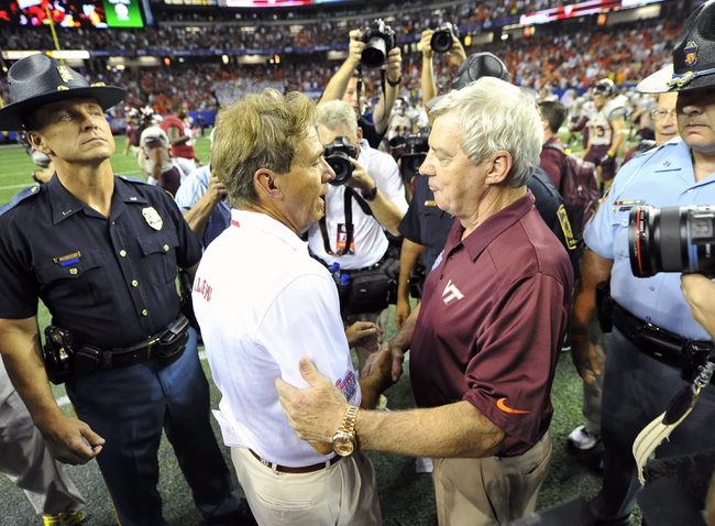 Aug 31, 2013; Atlanta, GA, USA; Alabama Crimson Tide head coach Nick Saban (left) hugs Virginia Tech Hokies head coach Frank Beamer after the 2013 Chick-fil-A Kickoff game at the Georgia Dome. Alabama won 35-10.  Mandatory Credit: Paul Abell-USA TODAY Sports