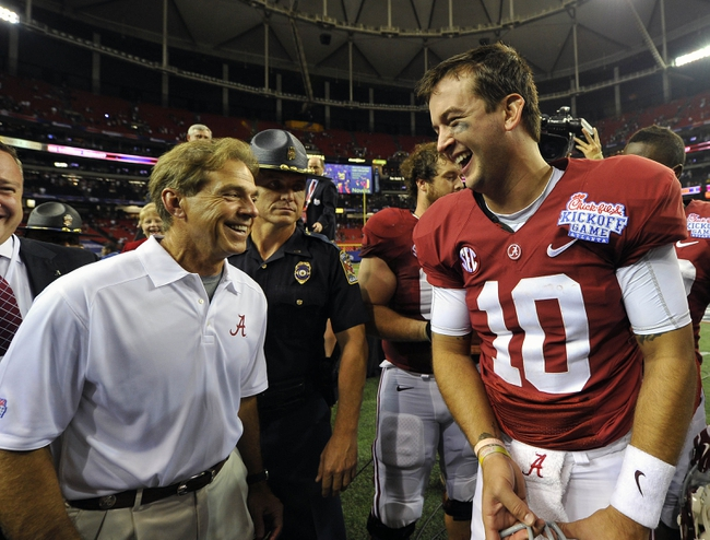 Aug 31, 2013; Atlanta, GA, USA; Alabama Crimson Tide quarterback AJ McCarron (10) and head coach Nick Saban react after defeating the Virginia Tech Hokies in the 2013 Chick-fil-A Kickoff game at the Georgia Dome. Alabama won 35-10.  Mandatory Credit: Paul Abell-USA TODAY Sports