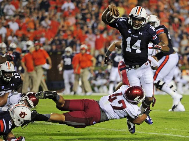 Aug 31, 2013; Auburn, AL, USA; Auburn Tigers quarterback Nick Marshall (14) is brought down by Washington State Cougars linebacker Cyrus Coen (42) at Jordan Hare Stadium. Mandatory Credit: Shanna Lockwood-USA TODAY Sports