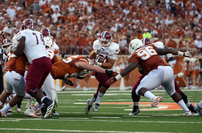 Aug 31, 2013; Austin, TX, USA; New Mexico State Aggies tailback Brandon Betancourt (21) carries the ball against the Texas Longhorns during the first half at Darrell K Royal-Texas Memorial Stadium. Mandatory Credit: Brendan Maloney-USA TODAY Sports