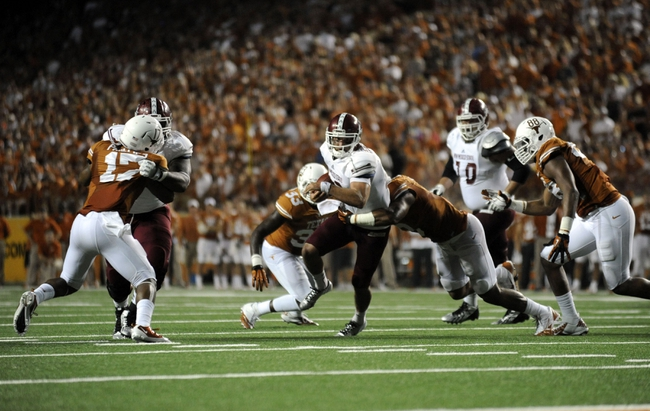 Aug 31, 2013; Austin, TX, USA; New Mexico State Aggies quarterback Andrew McDonald (12) carries the ball against the Texas Longhorns during the first half at Darrell K Royal-Texas Memorial Stadium. Mandatory Credit: Brendan Maloney-USA TODAY Sports