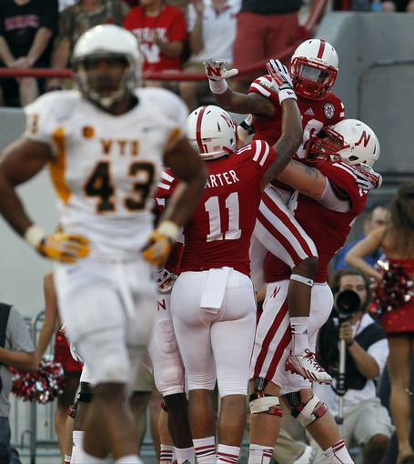 Aug 31, 2013; Lincoln, NE, USA; Nebraska Cornhuskers receiver Jamal Turner (10) celebrates his touchdown with Cethan Carter (11) during the game against the Wyoming Cowboys in the first half at Memorial Stadium. Mandatory Credit: Bruce Thorson-USA TODAY Sports