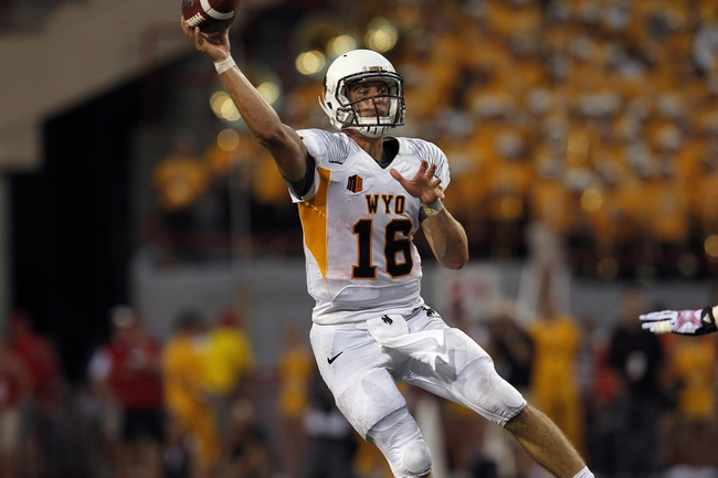 Aug 31, 2013; Lincoln, NE, USA; Wyoming Cowboys quarterback Brett Smith (16) throws agains the Nebraska Cornhuskers in the first half at Memorial Stadium. Mandatory Credit: Bruce Thorson-USA TODAY Sports