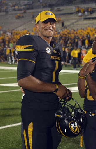 Aug 31, 2013; Columbia, MO, USA; Missouri Tigers quarterback James Franklin (1) smiles on the field after the game against the Murray State Racers at Faurot Field. Missouri won 58-14. Mandatory Credit: Denny Medley-USA TODAY Sports