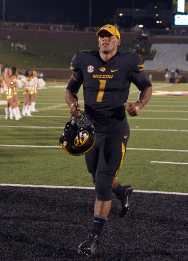 Aug 31, 2013; Columbia, MO, USA; Missouri Tigers quarterback James Franklin (1) runs off of the field after the game against the Murray State Racers at Faurot Field. Missouri won 58-14. Mandatory Credit: Denny Medley-USA TODAY Sports