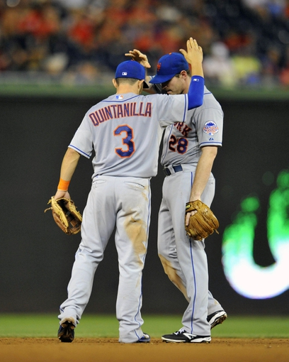 Aug 31, 2013; Washington, DC, USA; New York Mets teammates Omar Quintanilla (3) congratulates Daniel Murphy (28) after a game against the Washington Nationals at Nationals Park. The Mets defeated the Nationals 11-3. Mandatory Credit: Joy R. Absalon-USA TODAY Sports