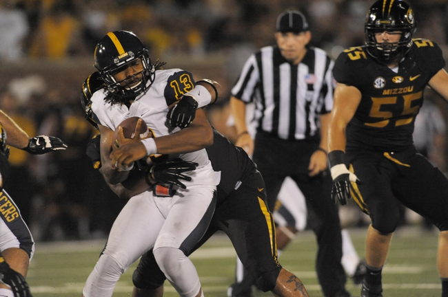 Aug 31, 2013; Columbia, MO, USA; Murray State Racers quarterback Maikhail Miller (13) is sacked by Missouri Tigers defensive lineman Harold Brantley (90) during the second half of the game at Faurot Field. Missouri won 58-14. Mandatory Credit: Denny Medley-USA TODAY Sports