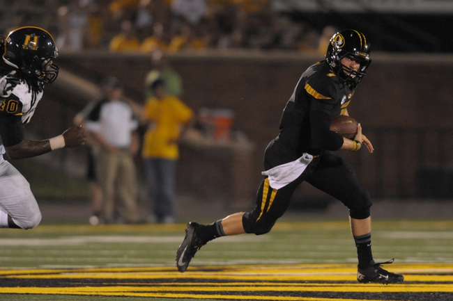 Aug 31, 2013; Columbia, MO, USA; Missouri Tigers quarterback Maty Mauk (7) runs the ball as Murray State Racers linebacker Travis Taylor (40) attempts the tackle during the second half of the game at Faurot Field. Missouri won 58-14. Mandatory Credit: Denny Medley-USA TODAY Sports