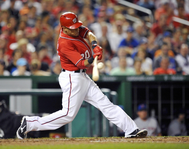 Aug 31, 2013; Washington, DC, USA; Washington Nationals shortstop Ian Desmond (20) hits a one-run broken bat single in the sixth inning against the New York Mets at Nationals Park. The Mets defeated the Nationals 11-3. Mandatory Credit: Joy R. Absalon-USA TODAY Sports