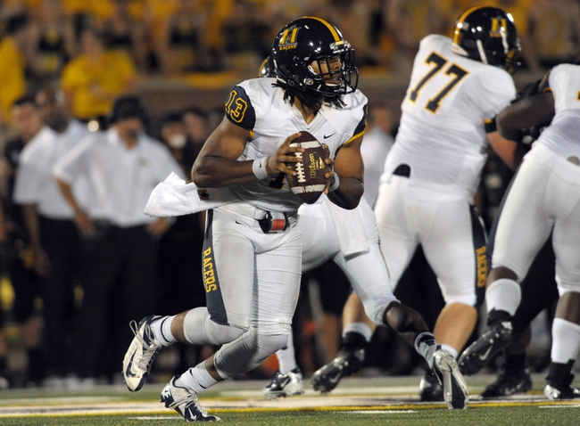 Aug 31, 2013; Columbia, MO, USA; Murray State Racers quarterback Maikhail Miller (13) looks to pass during the second half of the game against the Missouri Tigers at Faurot Field. Missouri won 58-14. Mandatory Credit: Denny Medley-USA TODAY Sports