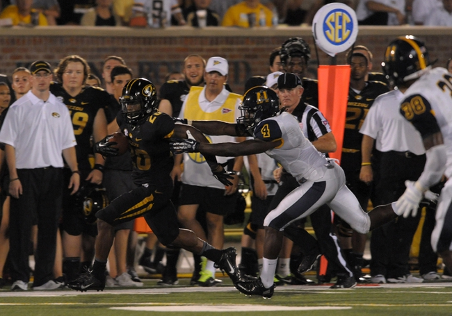 Aug 31, 2013; Columbia, MO, USA; Missouri Tigers running back Henry Josey (20) runs for a 68 yard touchdown as Murray State Racers cornerback Josh Manning (4) attempts the tackle during the second half of the game at Faurot Field. Missouri won 58-14. Mandatory Credit: Denny Medley-USA TODAY Sports