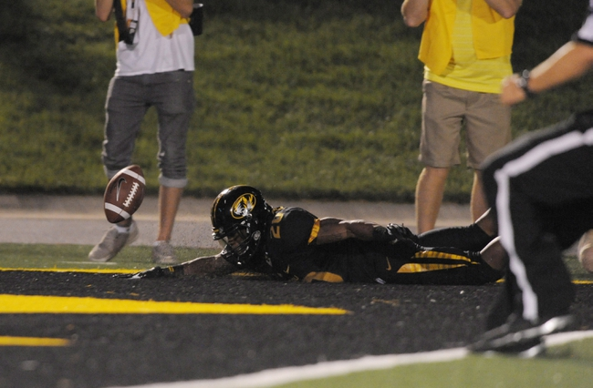 Aug 31, 2013; Columbia, MO, USA; Missouri Tigers running back Henry Josey (20) dives into the end zone on a 68 yard touchdown run during the second half of the game against the Murray State Racers at Faurot Field. Missouri won 58-14. Mandatory Credit: Denny Medley-USA TODAY Sports