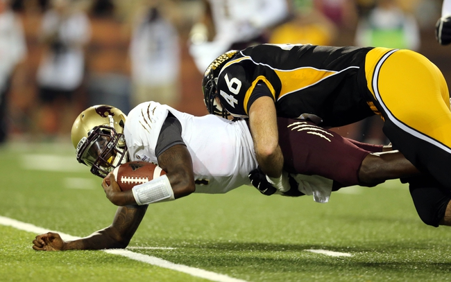 Aug 31, 2013; Hattiesburg, MS, USA; Texas State Bobcats quarterback Jordan Moore (4) is tackled by Southern Miss Golden Eagles defensive lineman Wil Freeman (46) in the third quarter at M.M. Roberts Stadium.Texas State won, 22-15. Mandatory Credit: Chuck Cook-USA TODAY Sports