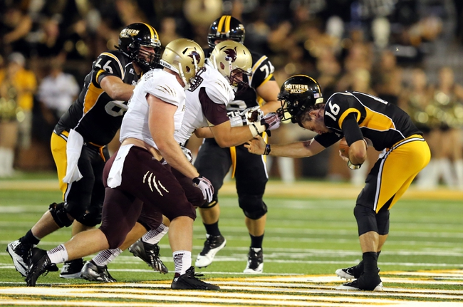 Aug 31, 2013; Hattiesburg, MS, USA; Southern Miss Golden Eagles quarterback Allan Bridgford (16) has his helmet taken off my Texas State Bobcats defensive tackle Blake McColloch (91) in the fourth quarter at M.M. Roberts Stadium. Texas State won, 22-15. Mandatory Credit: Chuck Cook-USA TODAY Sports