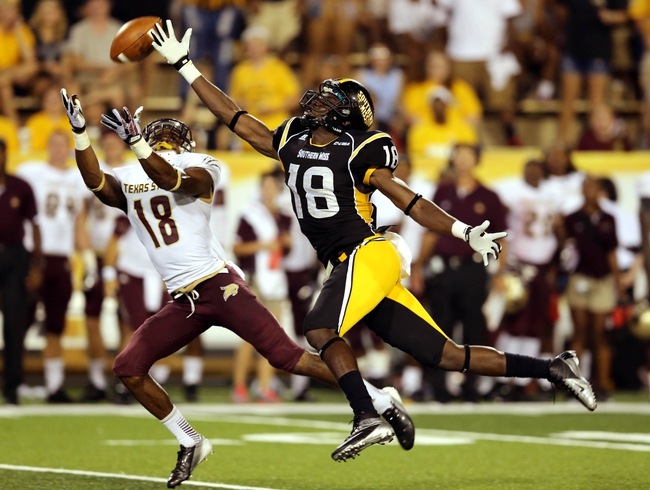 Aug 31, 2013; Hattiesburg, MS, USA; Texas State Bobcats cornerback Xavier Daniels (18) breaks up a pass intended for Southern Miss Golden Eagles wide receiver Dominique Sullivan (18) in the fourth quarter at M.M. Roberts Stadium. Texas State won, 22-15. Mandatory Credit: Chuck Cook-USA TODAY Sports