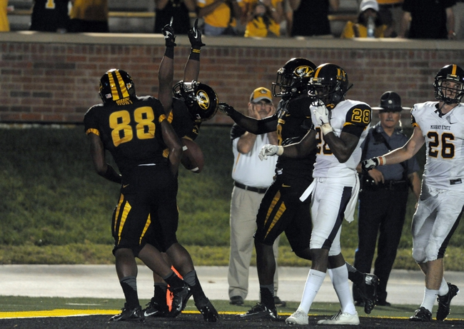 Aug 31, 2013; Columbia, MO, USA; Missouri Tigers running back Henry Josey (20) is congratulated by wide receiver Jimmie Hunt (88) after Josey's touchdown during the second half of the game against the Murray State Racers at Faurot Field. Missouri won 58-14. Mandatory Credit: Denny Medley-USA TODAY Sports