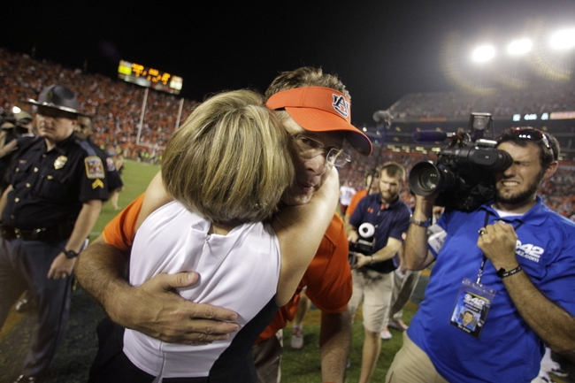Aug 31, 2013; Auburn, AL, USA; Auburn Tigers head coach Gus Malzahn hugs his wife Kristi after winning his first game as head coach.  The Tiger beat the Washington State Cougars 31-24 at Jordan Hare Stadium. Mandatory Credit: John Reed-USA TODAY Sports