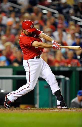 Aug 31, 2013; Washington, DC, USA; Washington Nationals third baseman Anthony Rendon (6) singles in the seventh inning against the New York Mets at Nationals Park. The Mets defeated the Nationals 11-3. Mandatory Credit: Joy R. Absalon-USA TODAY Sports