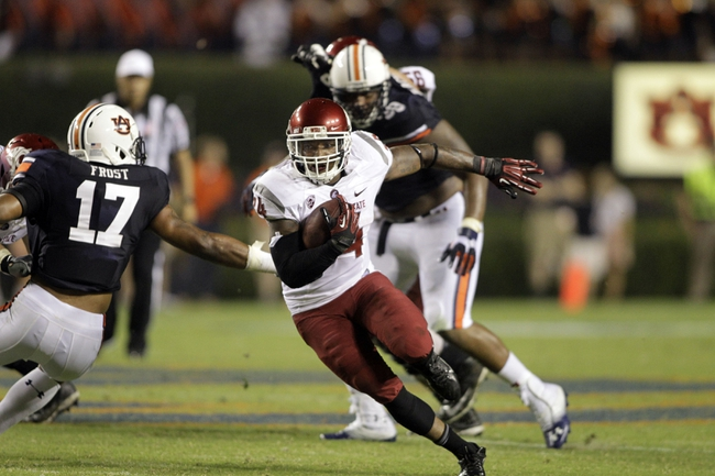 Aug 31, 2013; Auburn, AL, USA; Washington State Cougars running back Teondray Caldwell (34) carries against the Auburn Tigers at Jordan Hare Stadium.  The Tigers beat the Cougars 31-24. Mandatory Credit: John Reed-USA TODAY Sports