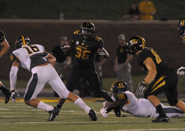 Aug 31, 2013; Columbia, MO, USA; Missouri Tigers running back Morgan Steward (36) runs the ball as Murray State Racers linebacker Qua Huzzie (15) attempts the tackle during the second half of the game at Faurot Field. Missouri won 58-14. Mandatory Credit: Denny Medley-USA TODAY Sports