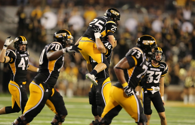 Aug 31, 2013; Hattiesburg, MS, USA; Southern Miss Golden Eagles kicker Corey Acosta (25) celebrates with Southern Miss Golden Eagles defensive lineman Wil Freeman (46) after making a fourth quarter field goal that gave them a 15-14 lead against the Texas State Bobcats at M.M. Roberts Stadium. Texas State won, 22-15. Mandatory Credit: Chuck Cook-USA TODAY Sports