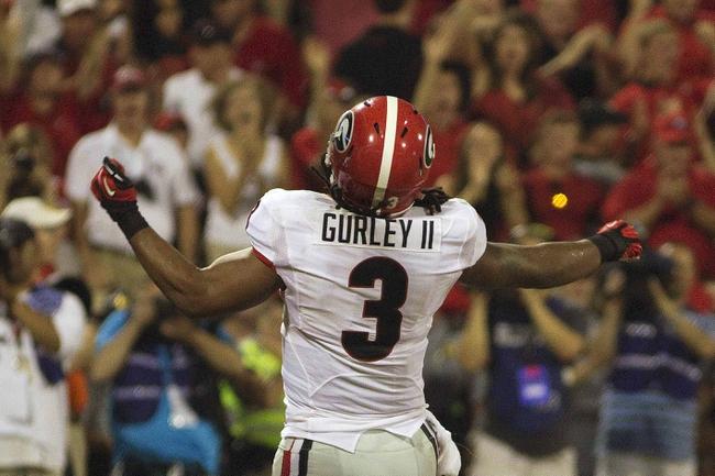 Aug 31, 2013; Clemson, SC, USA; Georgia Bulldogs running back Todd Gurley (3) celebrates after scoring a touchdown during the third quarter at Clemson Memorial Stadium. Mandatory Credit: Joshua S. Kelly-USA TODAY Sports