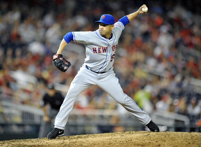 Aug 31, 2013; Washington, DC, USA; New York Mets starting pitcher Pedro Feliciano (55) throws in the seventh inning against the Washington Nationals at Nationals Park. The Mets defeated the Nationals 11-3. Mandatory Credit: Joy R. Absalon-USA TODAY Sports