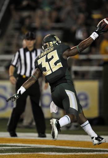 Aug 31, 2013; Waco, TX, USA; Baylor Bears running back Shock Linwood (32) scores a touchdown against the Wofford Terriers during the second half of the game at Floyd Casey Stadium. The Bears defeated the Terriers 69-3. Mandatory Credit: Jerome Miron-USA TODAY Sports