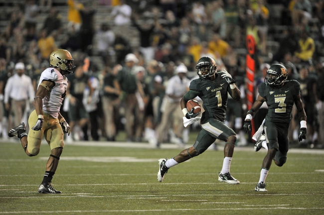Aug 31, 2013; Waco, TX, USA; Baylor Bears wide receiver Corey Coleman (1) scores a touchdown during the second half of the game against the Wofford Terriers at Floyd Casey Stadium. The Bears defeated the Terriers 69-3. Mandatory Credit: Jerome Miron-USA TODAY Sports