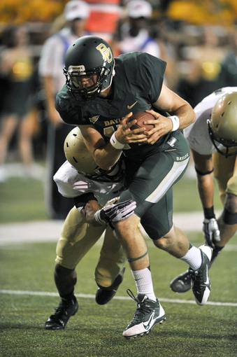 Aug 31, 2013; Waco, TX, USA; Baylor Bears quarterback Seth Russell (17) scores a rushing touchdown during the second half of the game against the Wofford Terriers at Floyd Casey Stadium. The Bears defeated the Terriers 69-3. Mandatory Credit: Jerome Miron-USA TODAY Sports