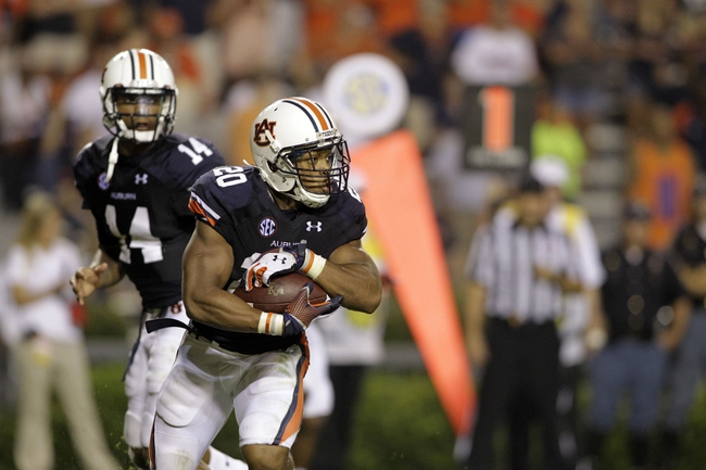 Aug 31, 2013; Auburn, AL, USA; Auburn Tigers running back Corey Grant (20) runs after taking a handoff from quarterback Nick Marshall (14) during the second half against the Washington State Cougars at Jordan Hare Stadium.  The Tigers beat the Cougars 31-24. Mandatory Credit: John Reed-USA TODAY Sports