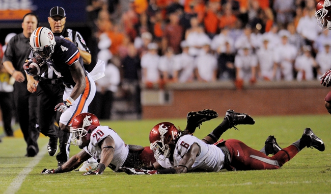 Aug 31, 2013; Auburn, AL, USA; Washington State Cougars safety Deone Bucannon (20) and cornerback Damante Horton (6) run Auburn Tigers wide receiver Quan Bray (4) out-of-bounds at Jordan Hare Stadium. The Tigers defeated the Cougars 31-24. Mandatory Credit: Shanna Lockwood-USA TODAY Sports