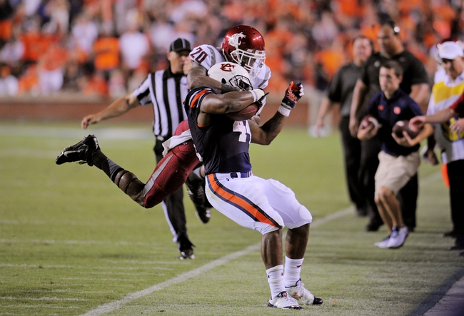 Aug 31, 2013; Auburn, AL, USA; Auburn Tigers running back Cameron Artis-Payne (44) is tackled by Washington State Cougars safety Deone Bucannon (20) at Jordan Hare Stadium. The Tigers defeated the Cougars 31-24. Mandatory Credit: Shanna Lockwood-USA TODAY Sports