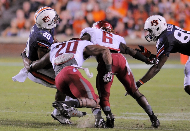 Aug 31, 2013; Auburn, AL, USA; Auburn Tigers running back Corey Grant (20) is brought down by Washington State Cougars safety Deone Bucannon (20) and Washington State Cougars cornerback Damante Horton (6) at Jordan Hare Stadium. The Tigers defeated the Cougars 31-24. Mandatory Credit: Shanna Lockwood-USA TODAY Sports