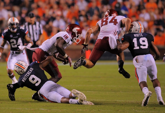 Aug 31, 2013; Auburn, AL, USA; Washington State Cougars wide receiver Kristoff Williams (18) is brought down by Auburn Tigers defensive back Jermaine Whitehead (9) as Washington State Cougars wide receiver River Cracraft (84) avoids a collision at Jordan Hare Stadium. The Tigers defeated the Cougars 31-24. Mandatory Credit: Shanna Lockwood-USA TODAY Sports