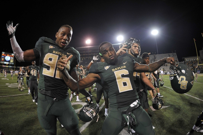 Aug 31, 2013; Waco, TX, USA; Baylor Bears defensive end Jamal Palmer (92) and safety Ahmad Dixon (6) celebrate the win over the Wofford Terriers at Floyd Casey Stadium. The Bears defeated the Terriers 69-3. Mandatory Credit: Jerome Miron-USA TODAY Sports