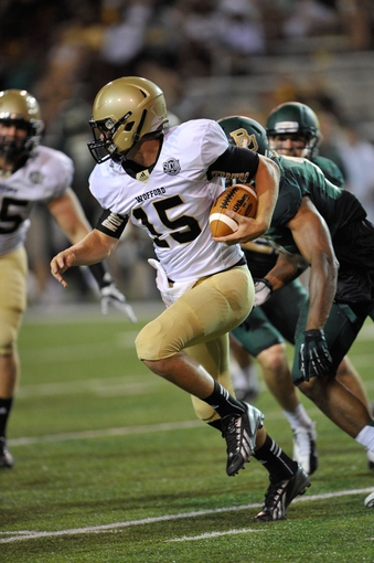 Aug 31, 2013; Waco, TX, USA; Wofford Terriers quarterback Michael Weimer (15) runs for a first down against the Baylor Bears during the second half of the game at Floyd Casey Stadium. The Bears defeated the Terriers 69-3. Mandatory Credit: Jerome Miron-USA TODAY Sports