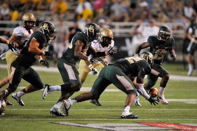 Aug 31, 2013; Waco, TX, USA; Baylor Bears defensive end Jamal Palmer (92) recovers a fumble against the Wofford Terriers during the second half of the game at Floyd Casey Stadium. The Bears defeated the Terriers 69-3. Mandatory Credit: Jerome Miron-USA TODAY Sports