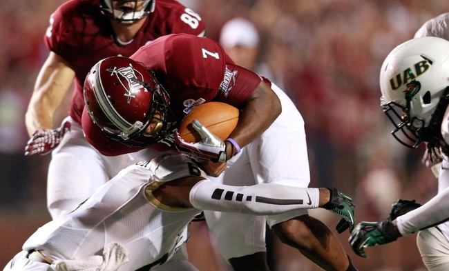 Aug 31, 2013; Troy, AL, USA; Troy Trojans quarterback Deon Anthony (7) is hit by UAB Blazers safety Nick Jackson (6) at Veterans Memorial Stadium. The Trojans defeated the Blazers 34-31 in Overtime. Mandatory Credit: Marvin Gentry-USA TODAY Sports