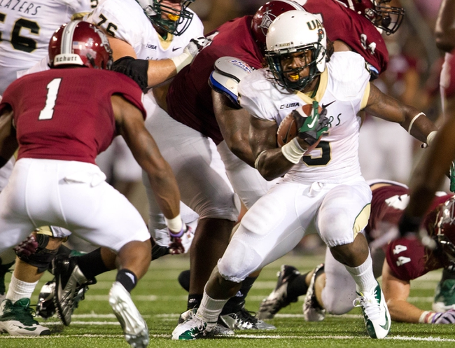Aug 31, 2013; Troy, AL, USA;  UAB Blazers running back Darrin Reaves  (5) carries against the Troy Trojans at Veterans Memorial Stadium. The Trojans defeated the Blazers 34-31 in Overtime. Mandatory Credit: Marvin Gentry-USA TODAY Sports