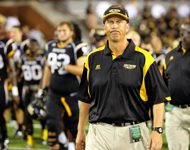 Aug 31, 2013; Hattiesburg, MS, USA; Southern Miss Golden Eagles head coach Todd Monken walks off the field after losing to the Texas State Bobcats at M.M. Roberts Stadium.Texas State won 22-15. Mandatory Credit: Chuck Cook-USA TODAY Sports