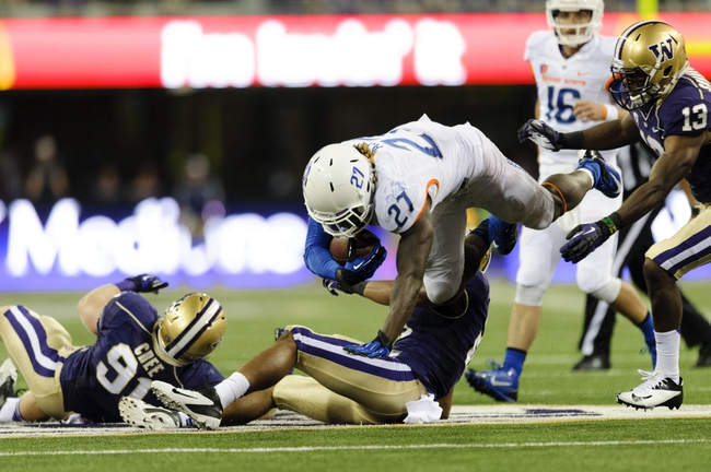 Aug 31, 2013; Seattle, WA, USA; Boise State Broncos running back Jay Ajayi (27) dives over Washington Huskies defensive back Marcus Peters (21) for more yards during the 1st half at Husky Stadium. Mandatory Credit: Steven Bisig-USA TODAY Sports