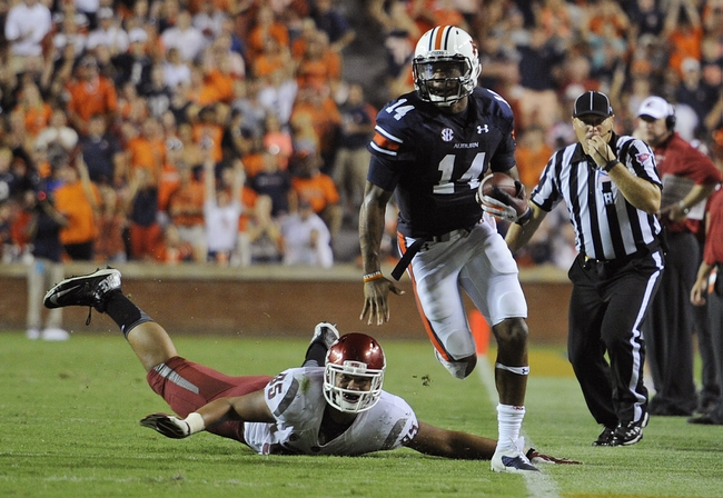 Aug 31, 2013; Auburn, AL, USA; Auburn Tigers cornerback Chris Davis (11) runs past the defense of Washington State Cougars wide receiver John Thompson (85). The Tigers defeated the Cougars 31-24. Mandatory Credit: Shanna Lockwood-USA TODAY Sports