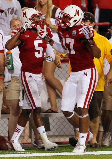 Aug 31, 2013; Lincoln, NE, USA; Nebraska Cornhuskers defenders Josh Mitchell (5) and Ciante Evens (17) celebrate as the last pass falls incomplete to end the game against the Wyoming Cowboys at Memorial Stadium. Nebraska won 37-34. Mandatory Credit: Bruce Thorson-USA TODAY Sports