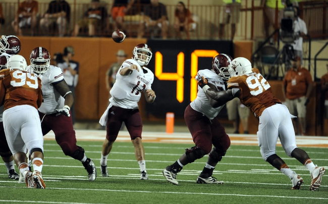 Aug 31, 2013; Austin, TX, USA; New Mexico State Aggies quarterback Andrew McDonald (12) passes the ball against the Texas Longhorns during the second half at Darrell K Royal-Texas Memorial Stadium. Texas beat New Mexico State 56-7. Mandatory Credit: Brendan Maloney-USA TODAY Sports