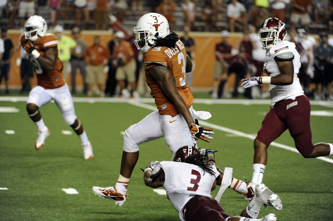 Aug 31, 2013; Austin, TX, USA; Texas Longhorns lrunning back Jalen Overstreet (3) carries the ball against the New Mexico State Aggies during the second half at Darrell K Royal-Texas Memorial Stadium. Texas beat New Mexico State 56-7. Mandatory Credit: Brendan Maloney-USA TODAY Sports