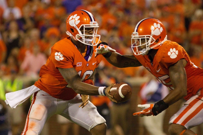 Aug 31, 2013; Clemson, SC, USA; Clemson Tigers quarterback Tajh Boyd (10) hands off the ball to running back Roderick McDowell (25) during the fourth quarter against the Georgia Bulldogs at Clemson Memorial Stadium. Tigers won 38-35. Mandatory Credit: Joshua S. Kelly-USA TODAY Sports