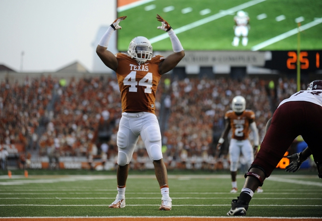 Aug 31, 2013; Austin, TX, USA; Texas Longhorns defensive end Jackson Jeffcoat (44) reacts against the New Mexico State Aggies during the first half at Darrell K Royal-Texas Memorial Stadium. Texas beat New Mexico State 56-7. Mandatory Credit: Brendan Maloney-USA TODAY Sports