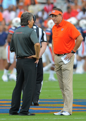 Aug 31, 2013; Auburn, AL, USA; Auburn Tigers head coach Gus Malzahn speaks with Washington State Cougars head coach Mike Leach prior to the game at Jordan Hare Stadium. Mandatory Credit: Shanna Lockwood-USA TODAY Sports